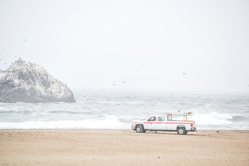 white pickup truck near shore