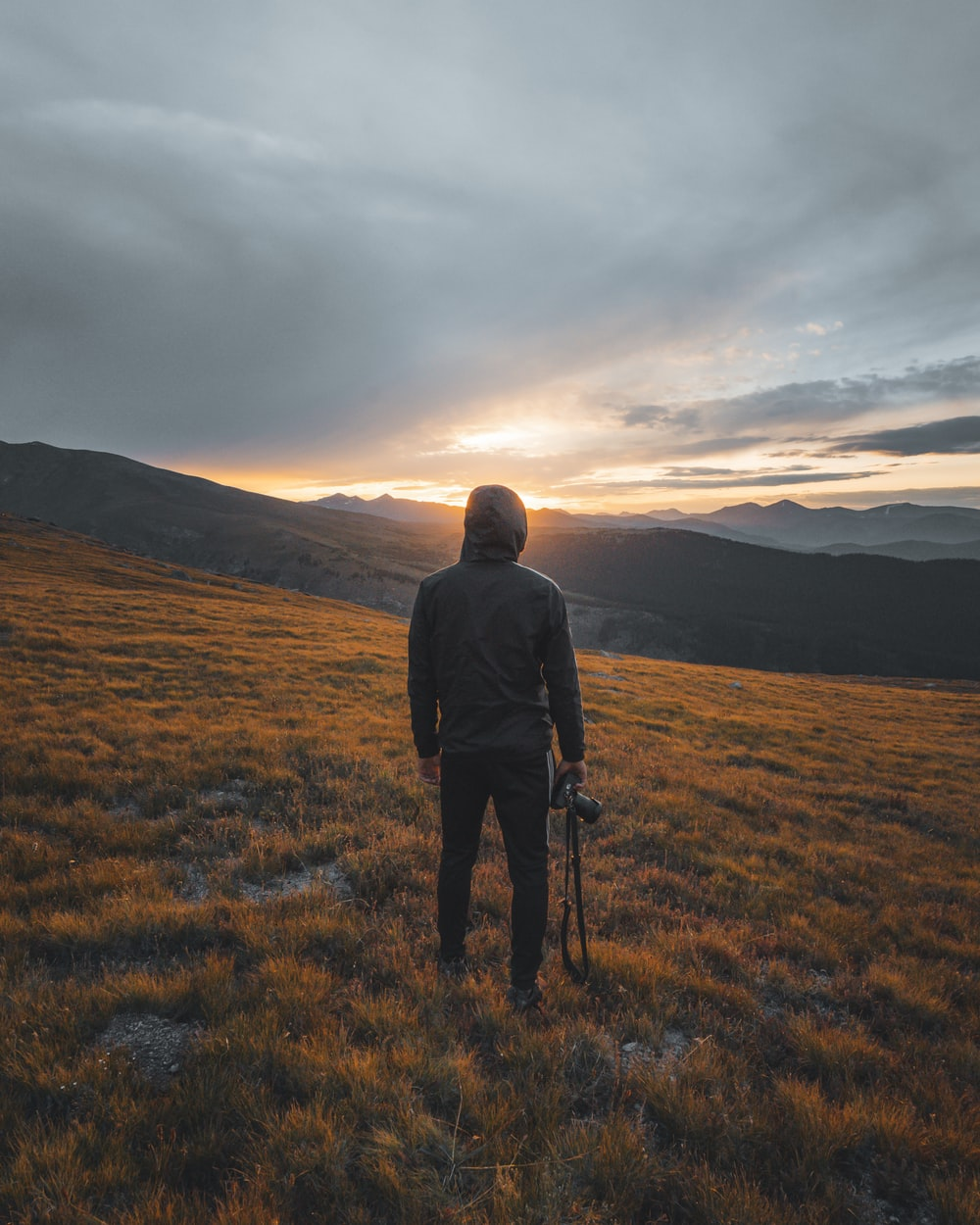 man stands on grass field