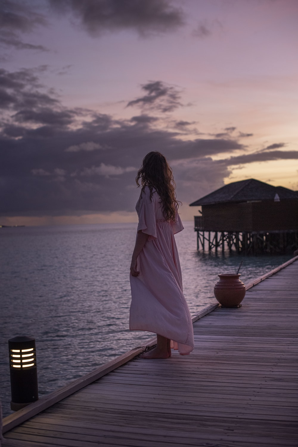 woman stands on dock