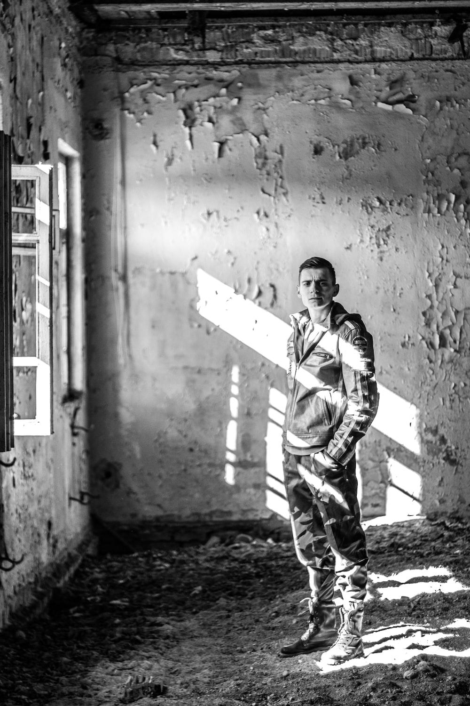 man standing inside empty room
