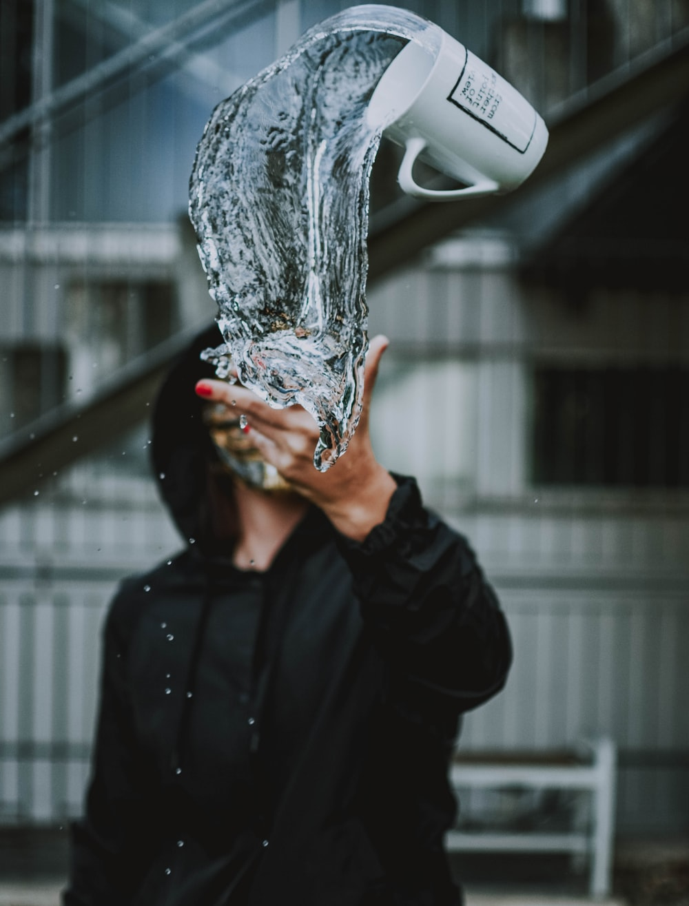 person throw mug with water