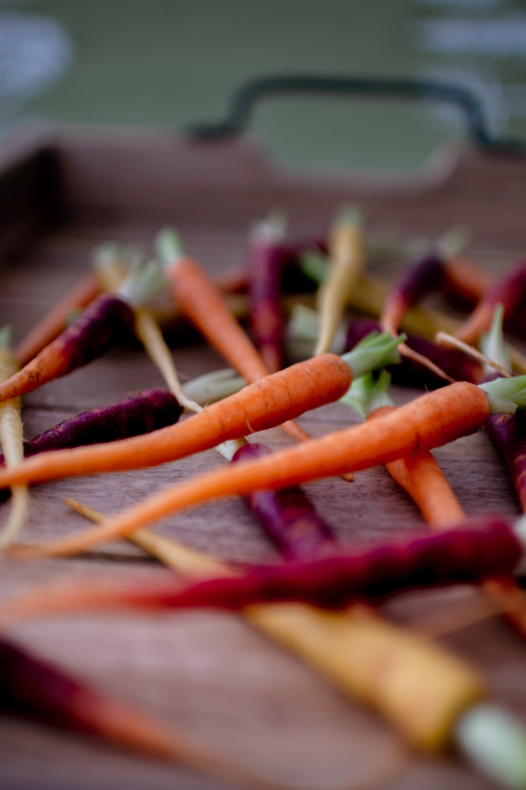 Baby carrots on wooden trail