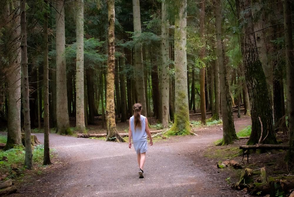 girl walking near trees