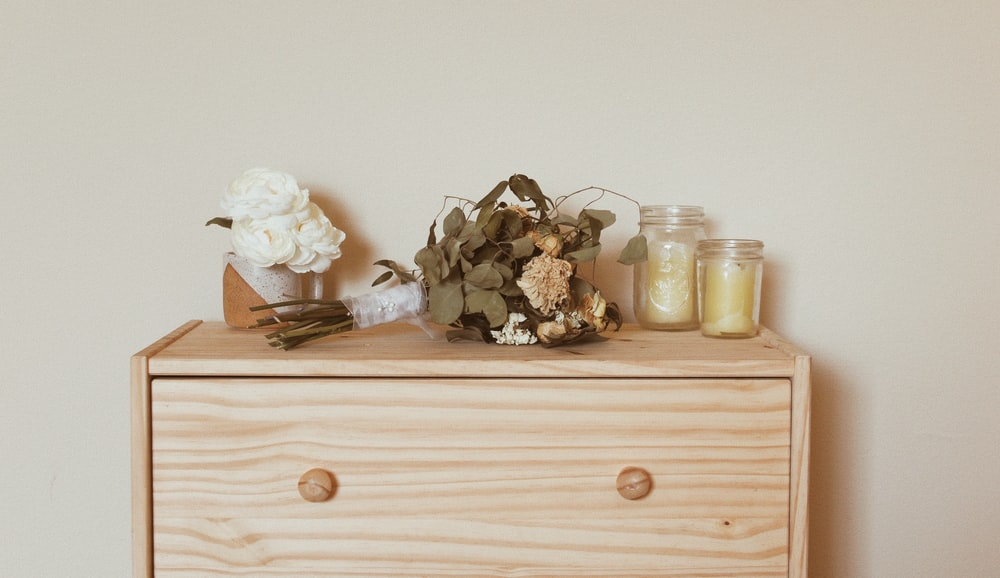 two glass jars on dresser
