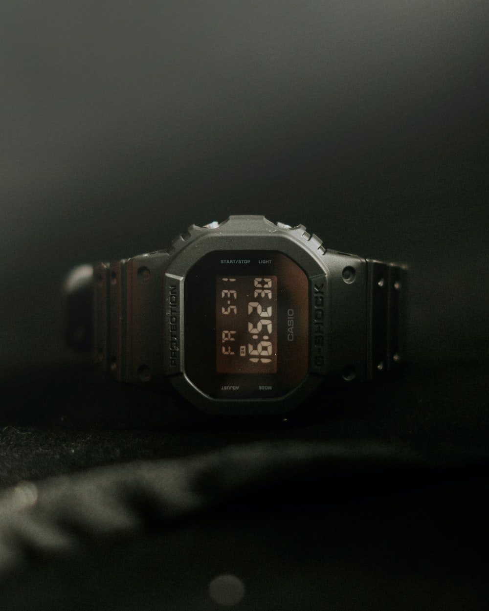 silver-colored digital watch