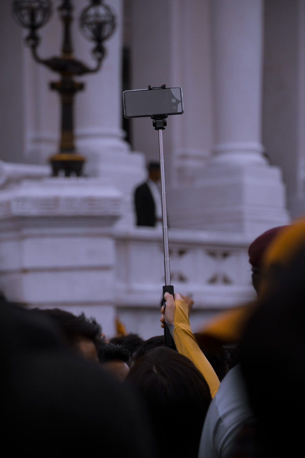 person holding gray monopod