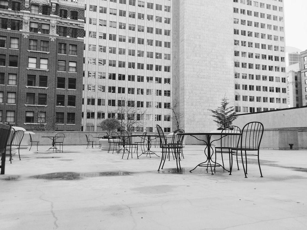 black metal chair near high-rise building