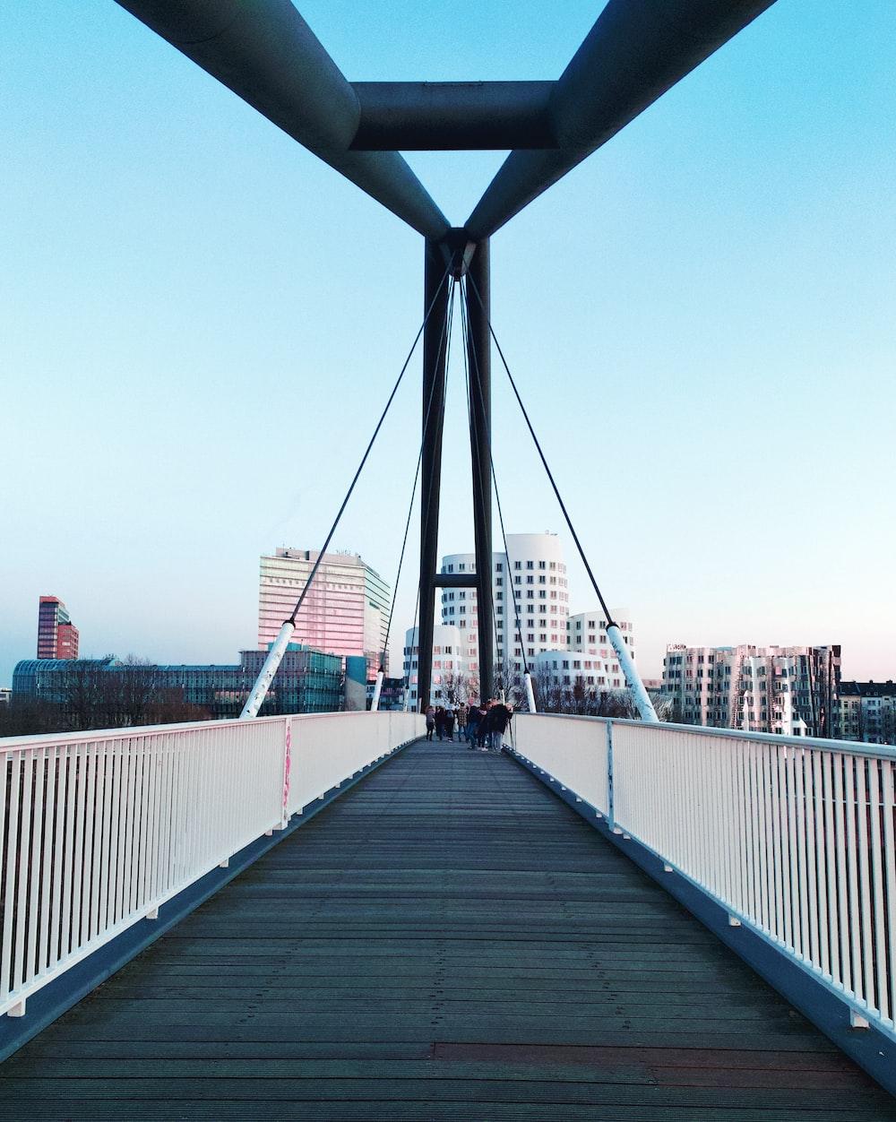 bridge near building during daytime photo