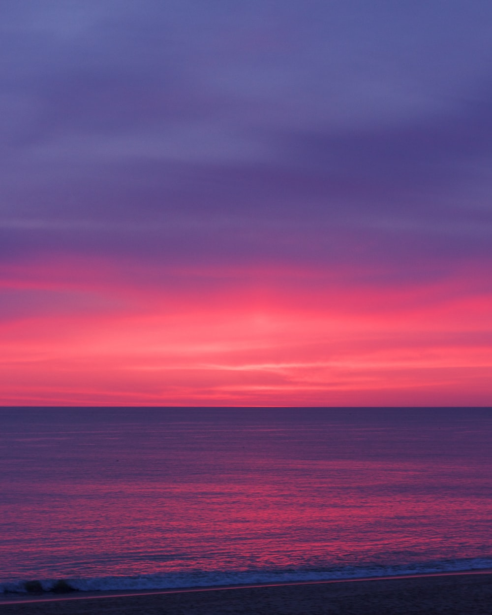 body of water during sunrise photo
