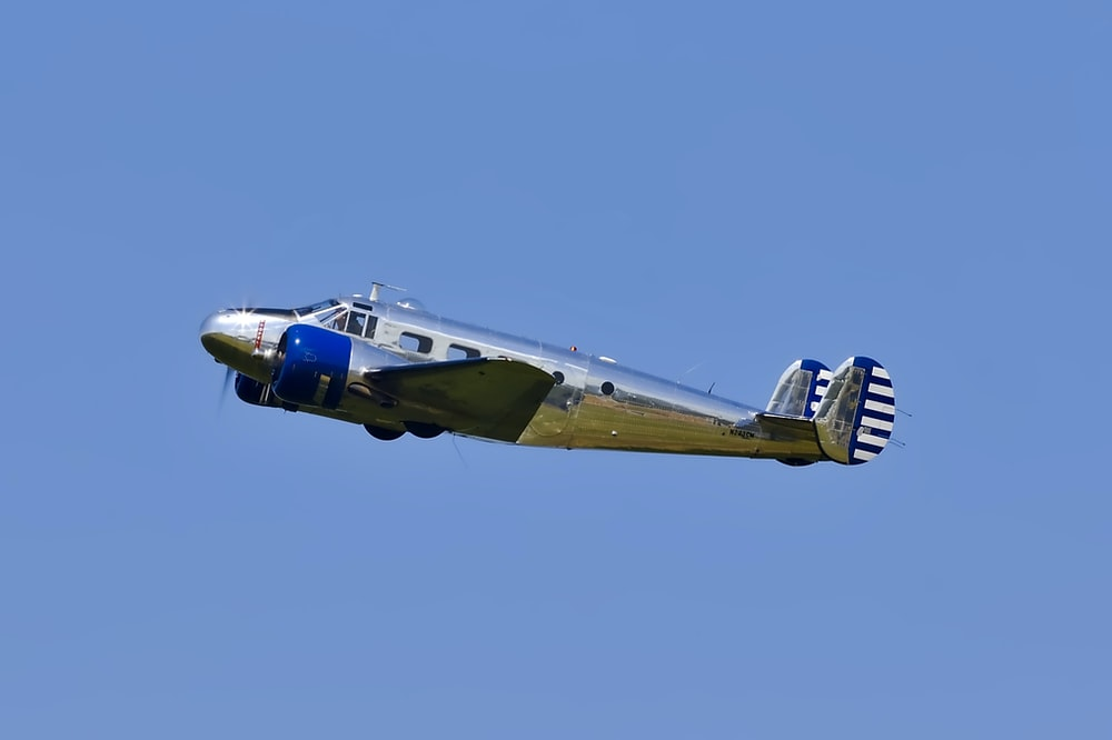 flying blue and gray plane