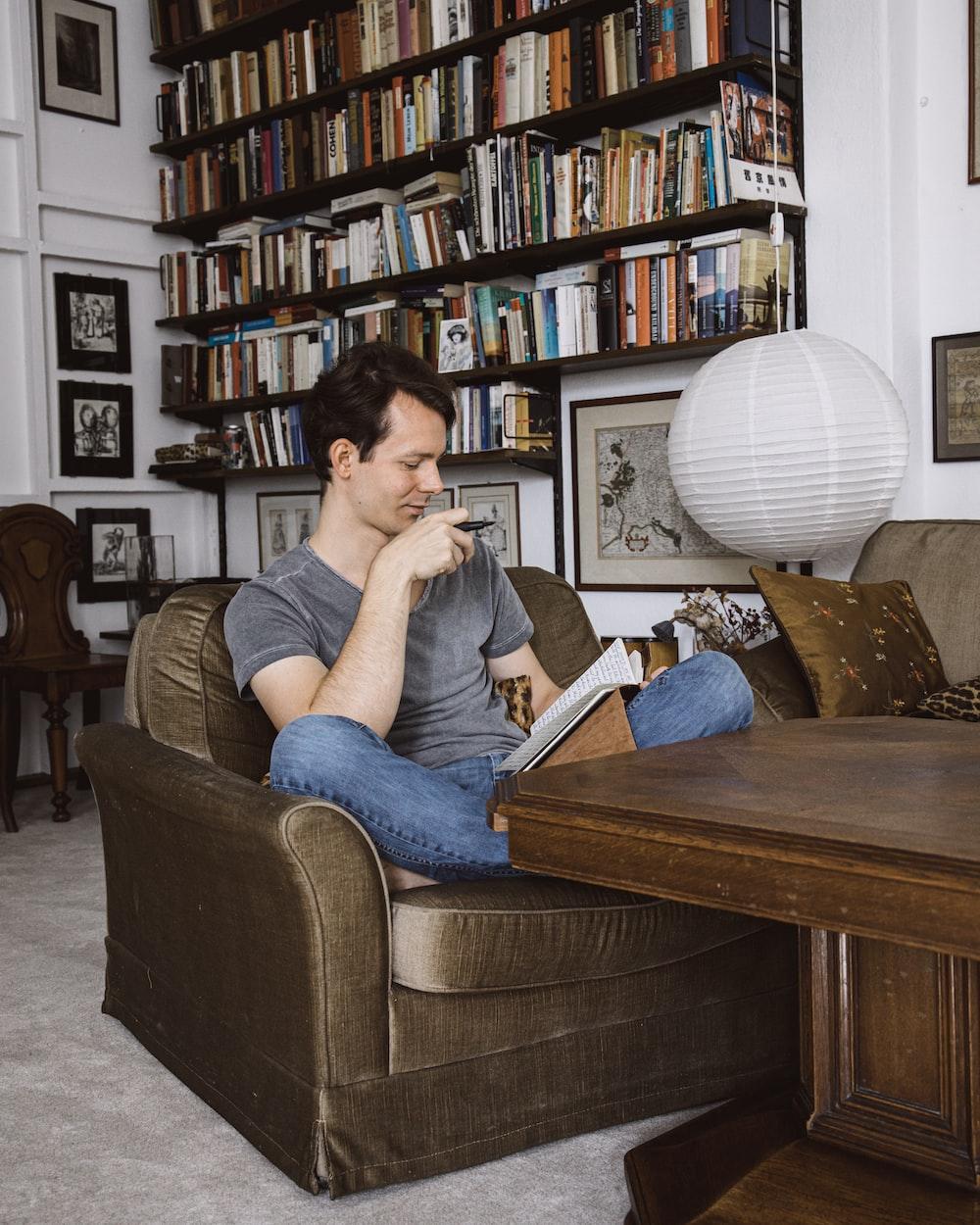 man sitting on sofa chair