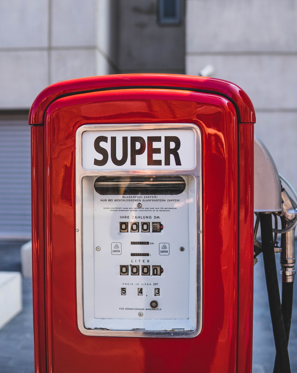 red and white Super gas dispenser