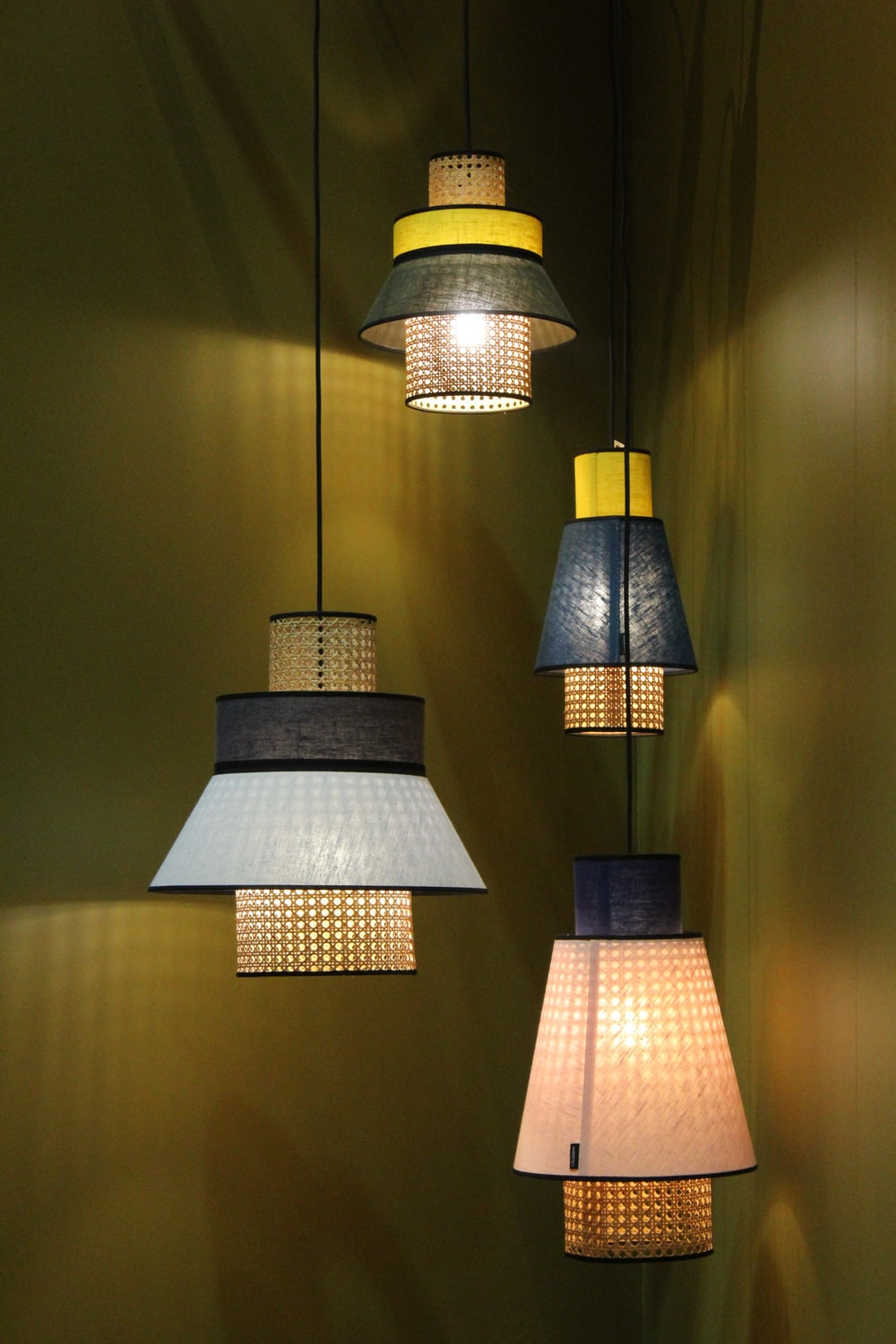 four assorted-color pendant lamps turned on