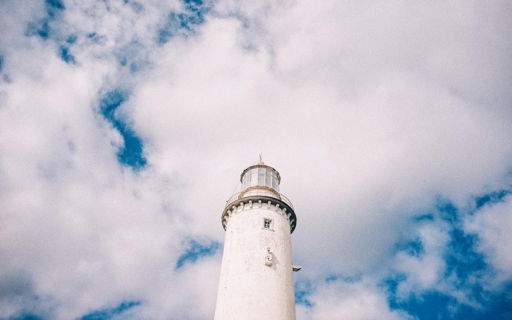white light house at daytime