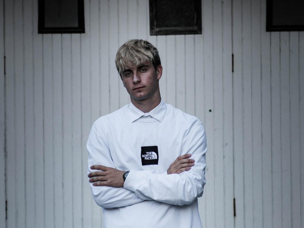 man wearing white sweatshirt