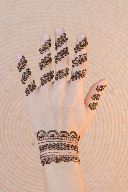 left human hand with henna