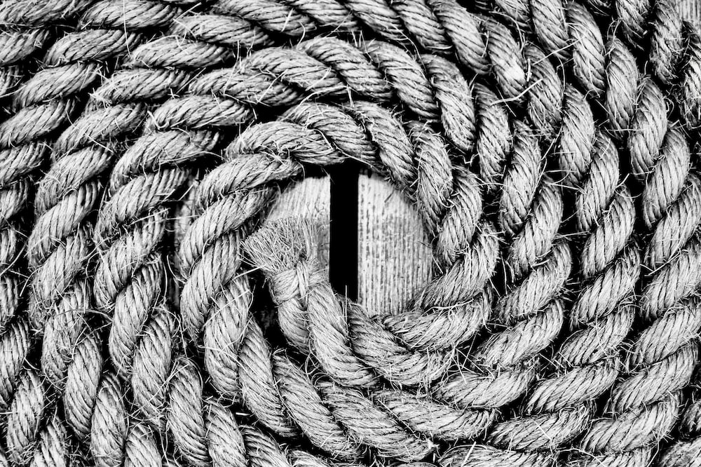 grayscale photography of braided rope