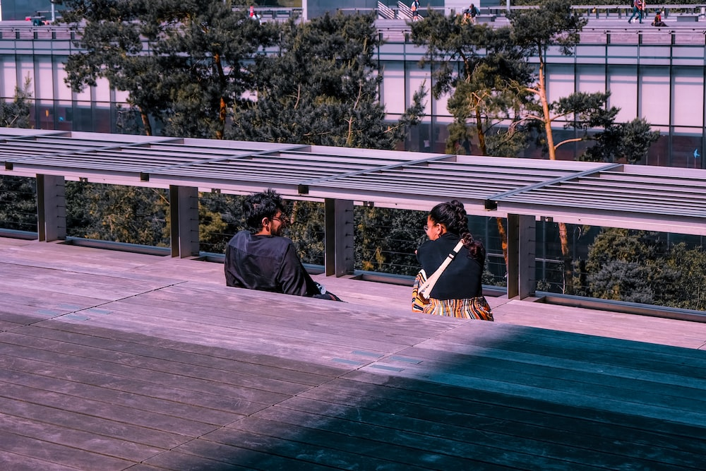 man and woman talking to each other during daytime