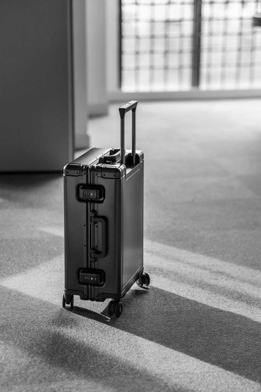 grey hard case luggage