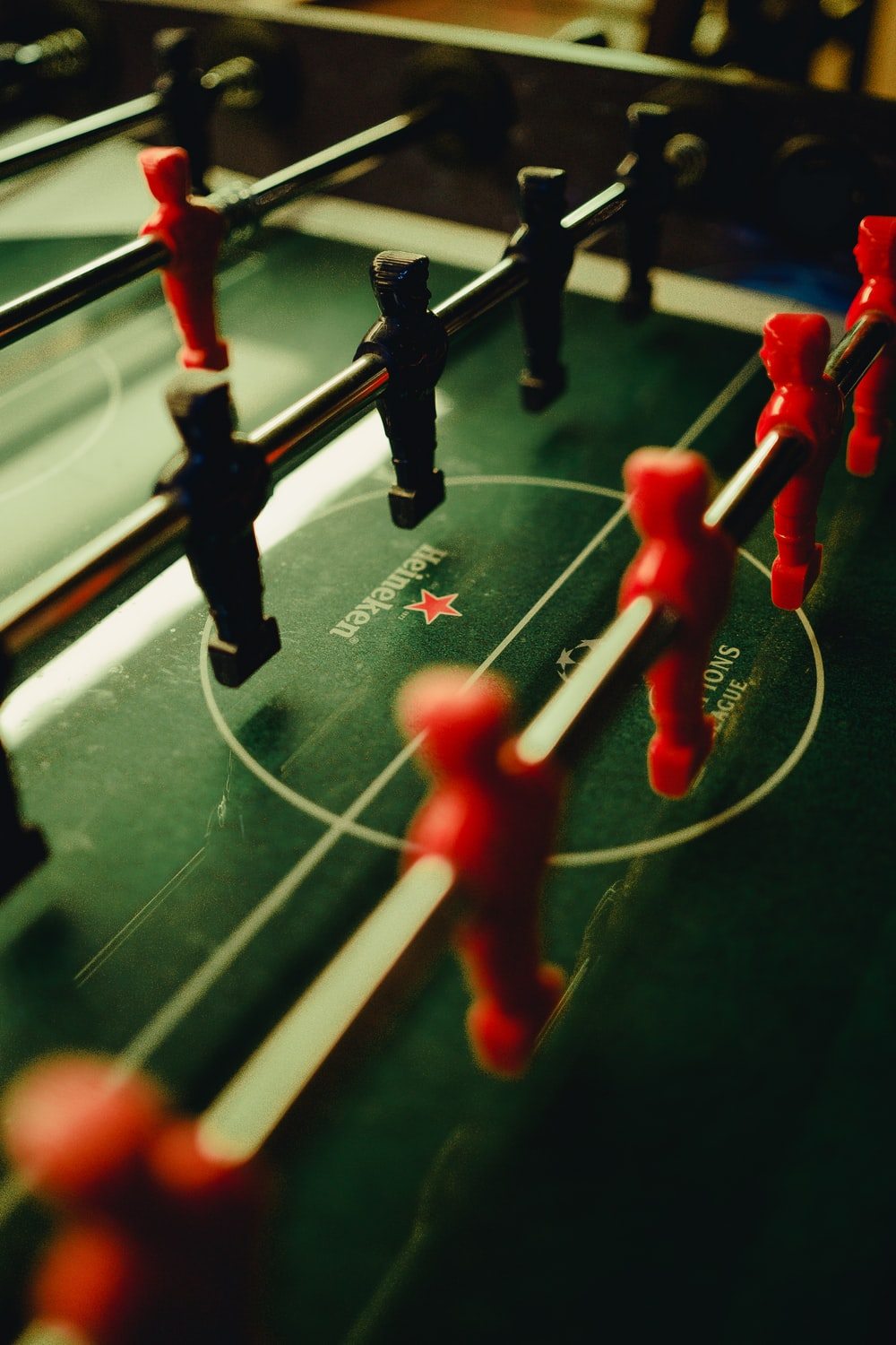 selective-focus photograph of foosball table