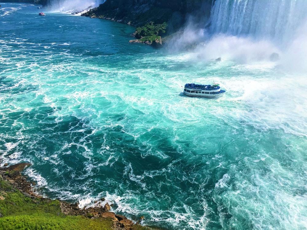 boat near waterfall