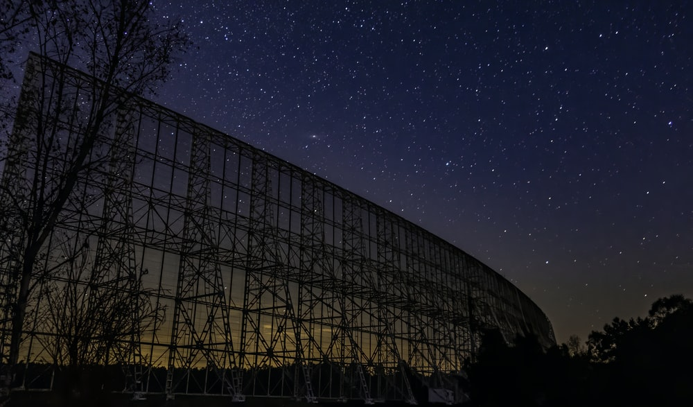 silhouette of metal frame structure at night