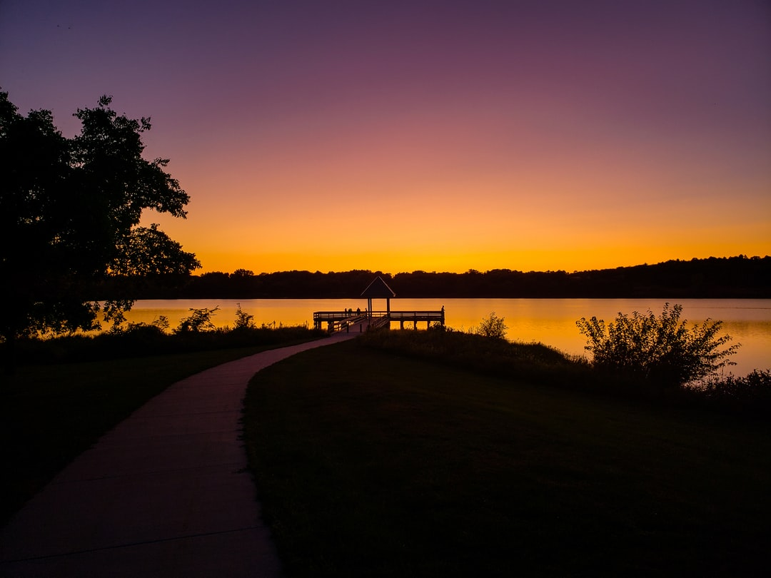 Fishing dock on cloudless sundown.
