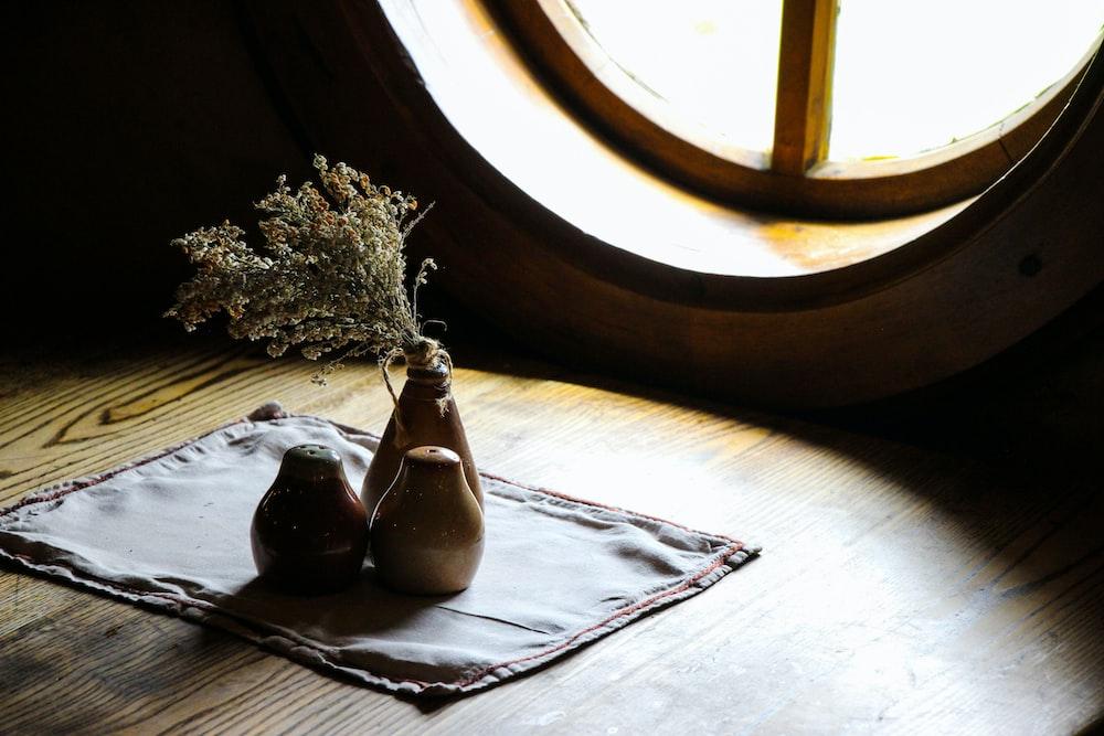 three brown vases