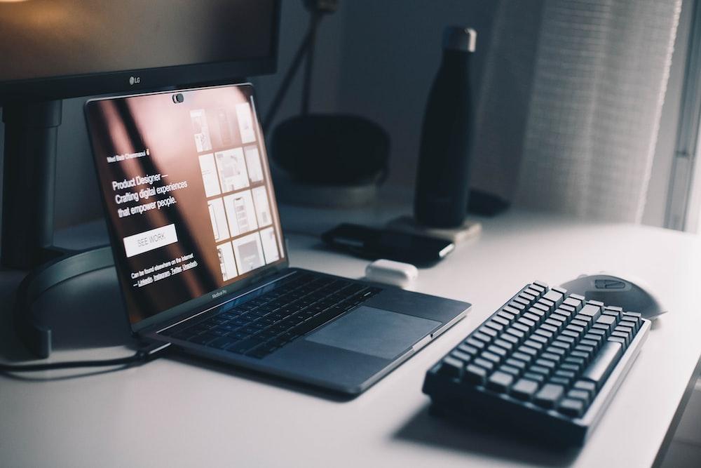 black keyboard beside laptop