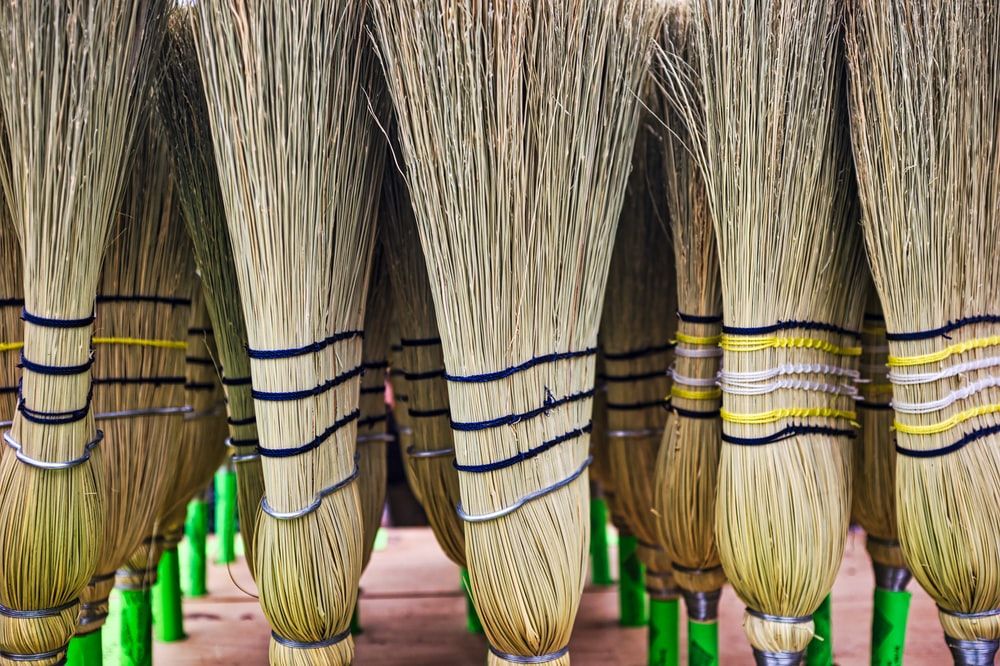shallow focus photo of broom