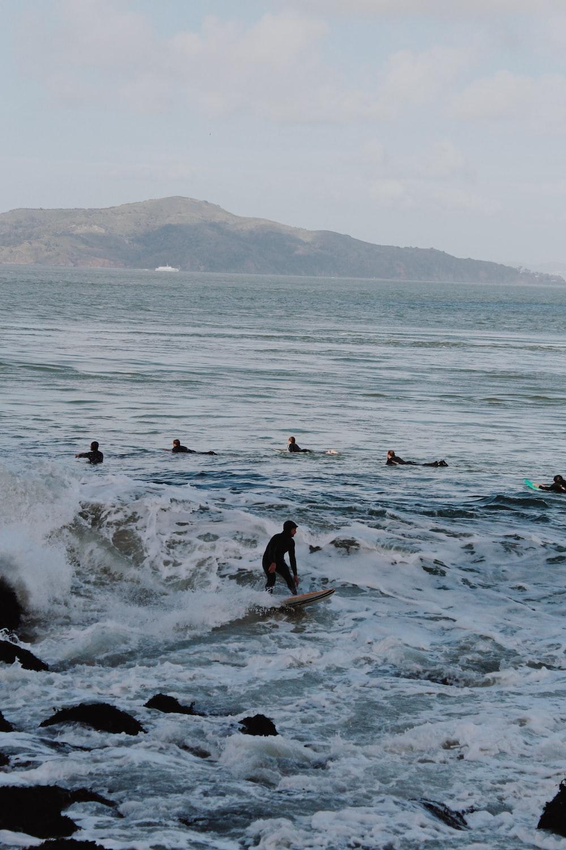 people in ocean during daytime