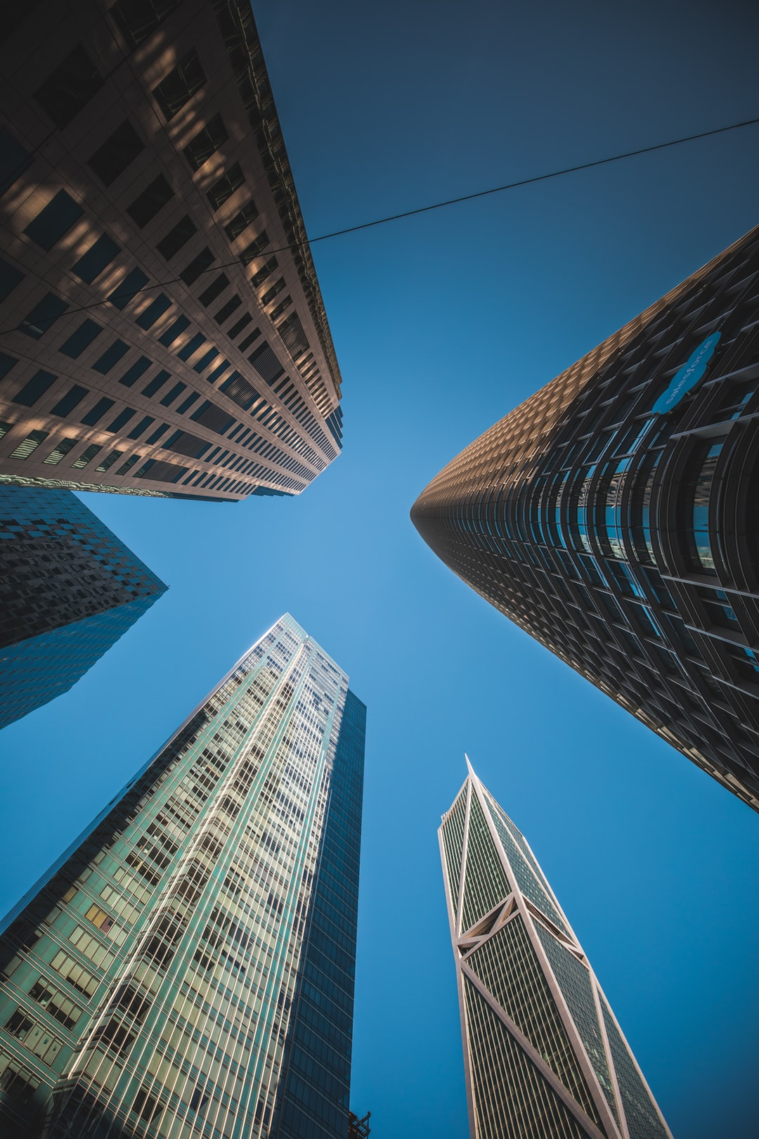 Look-up shot from Downtown San Francisco (specifically Soma, Financial District). This was taken between Salesforce Tower and Millenium Tower at the intersection of Fremont St. and Mission St.