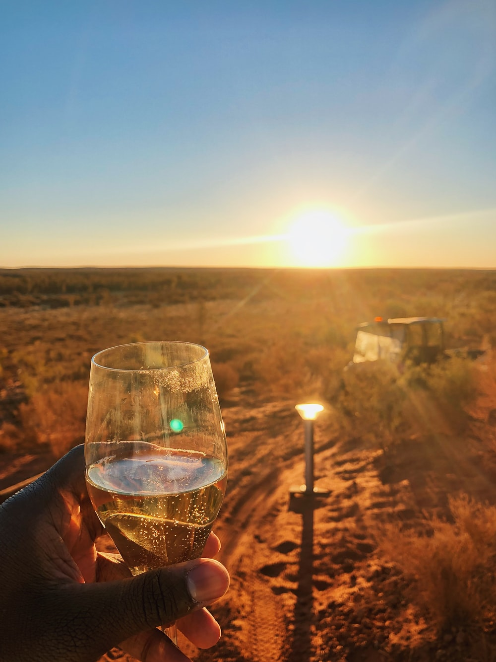 clear champagne glass across sunset