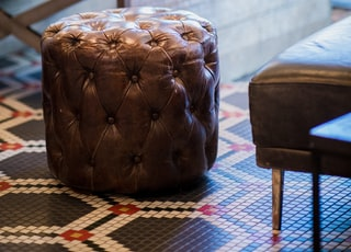 tufted brown leather ottoman