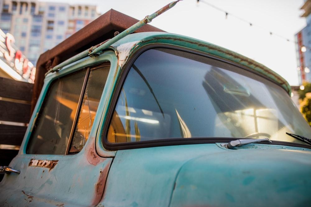 blue vehicle during daytime
