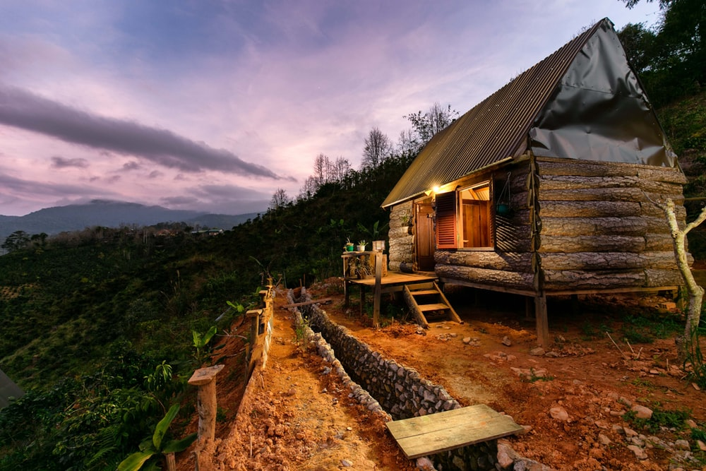 gray wooden cabin with porch during dawn