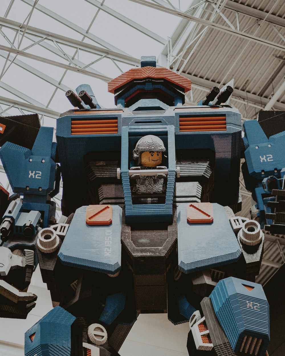 architectural photography of blue and black robot statue