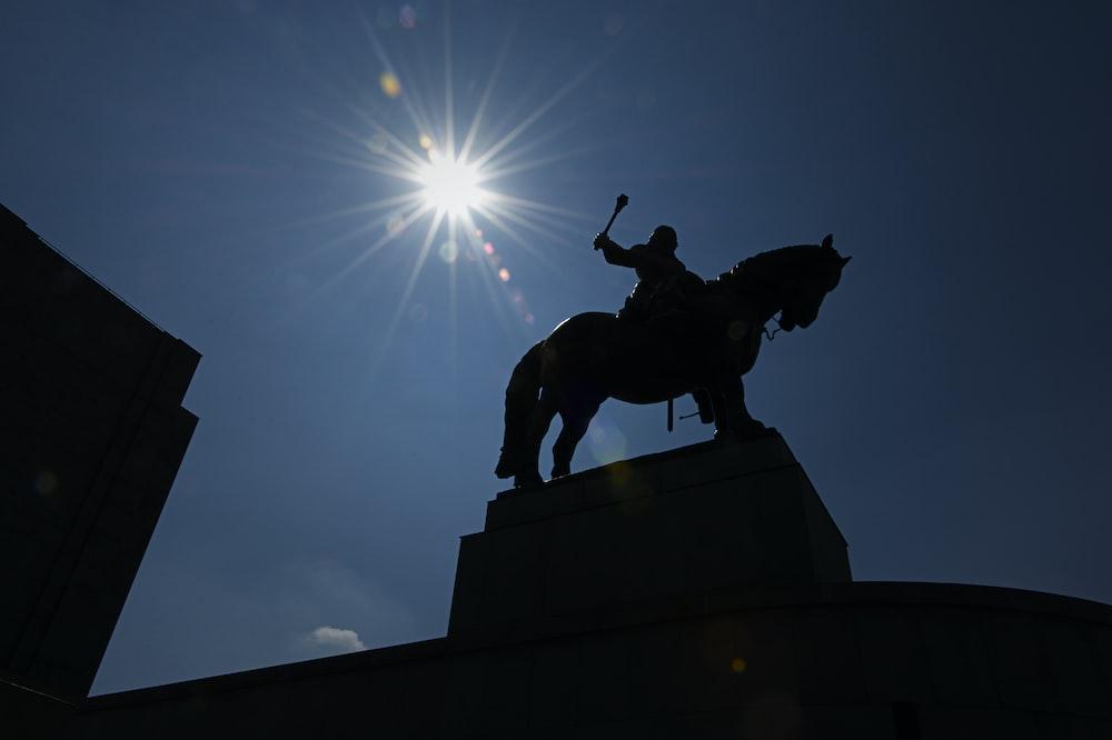 man on horse monument under the sun