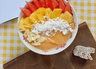 sliced fruits in bowl