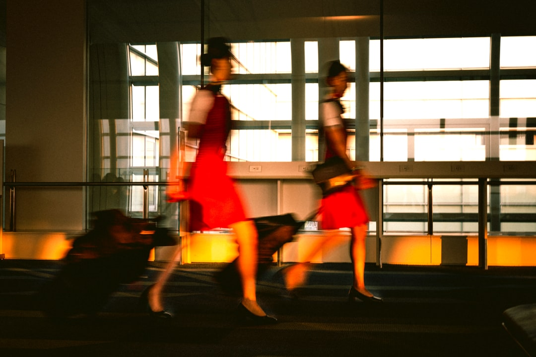 two stewardess are walking in the airport.