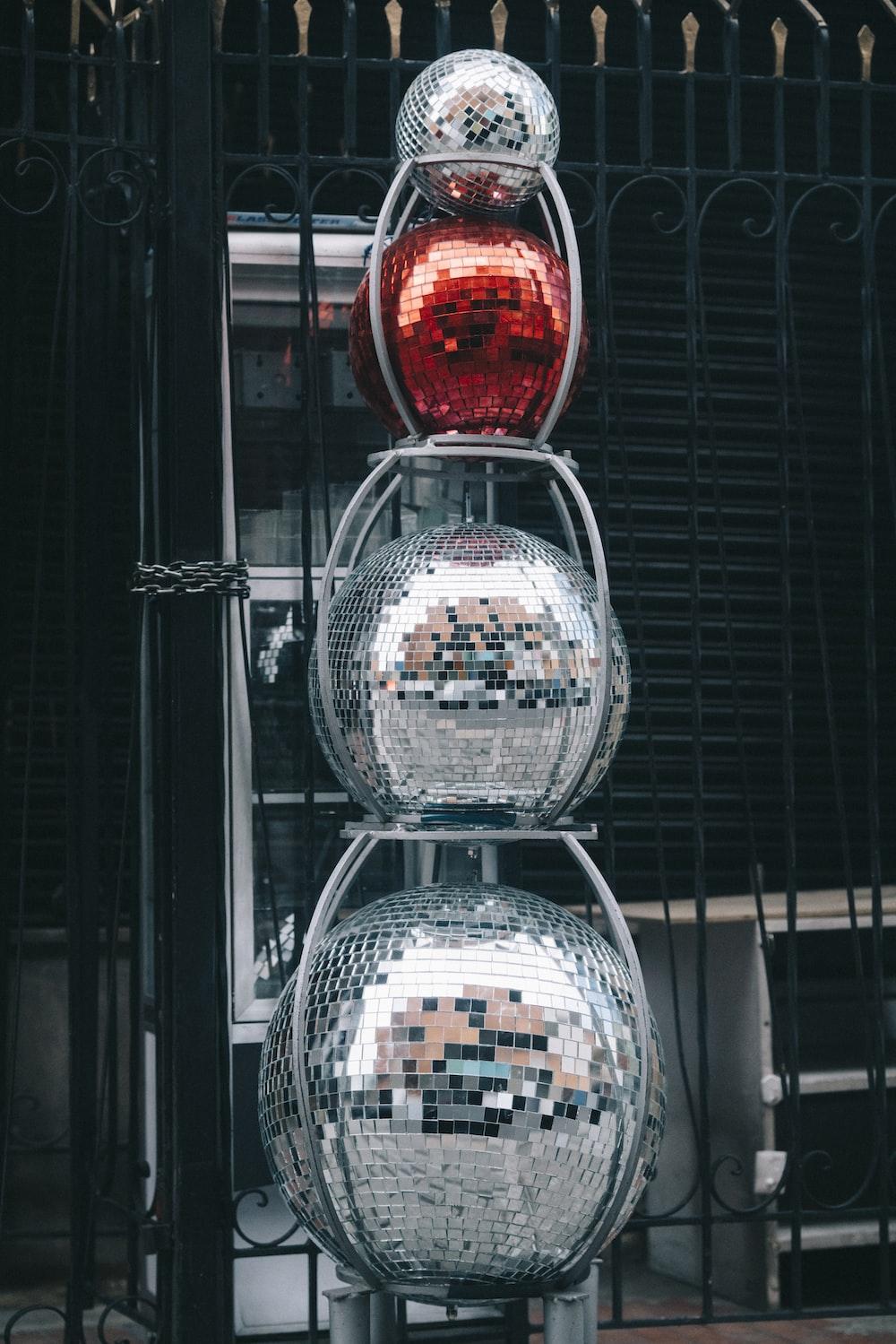 four gray silver disco balls