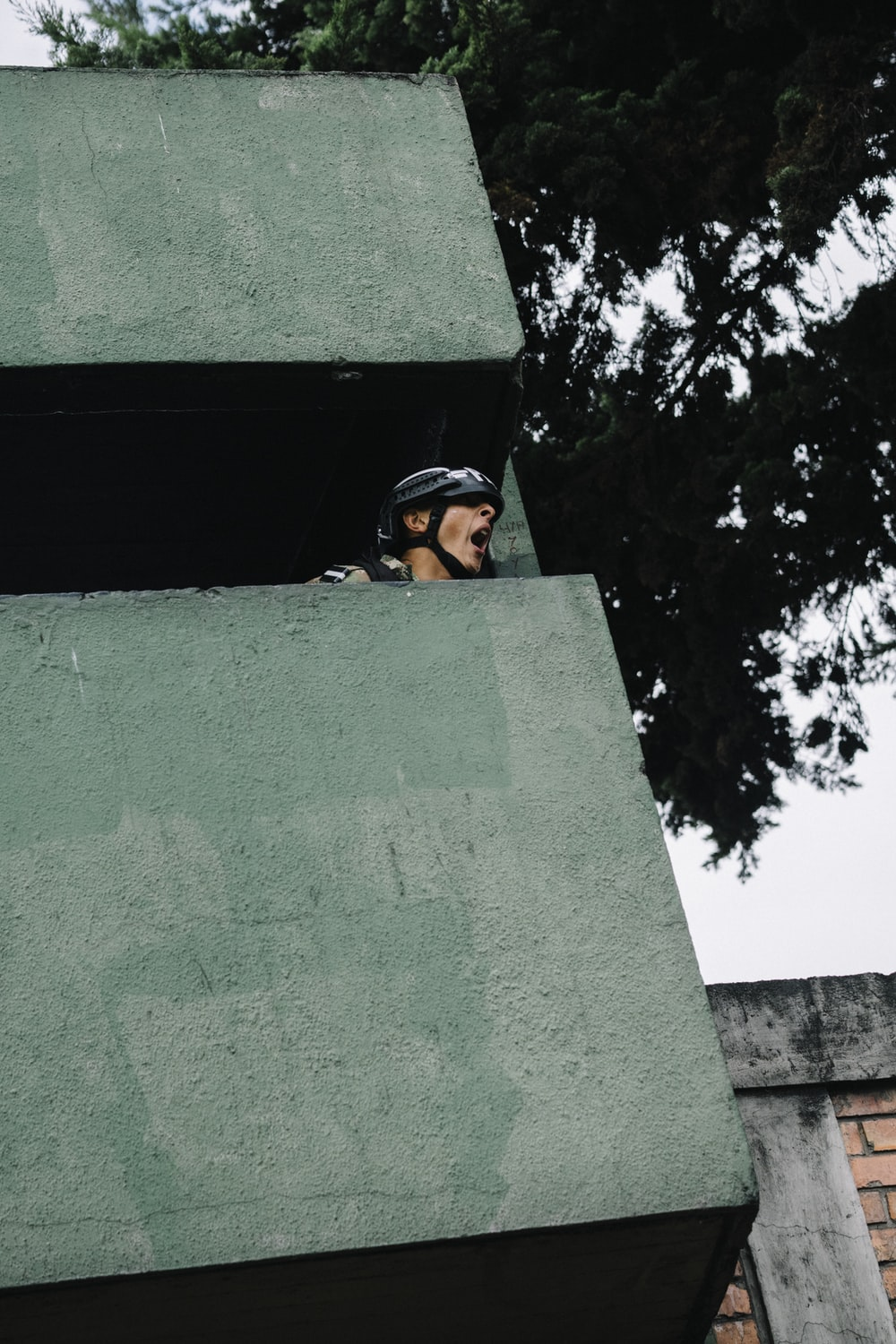person in green building