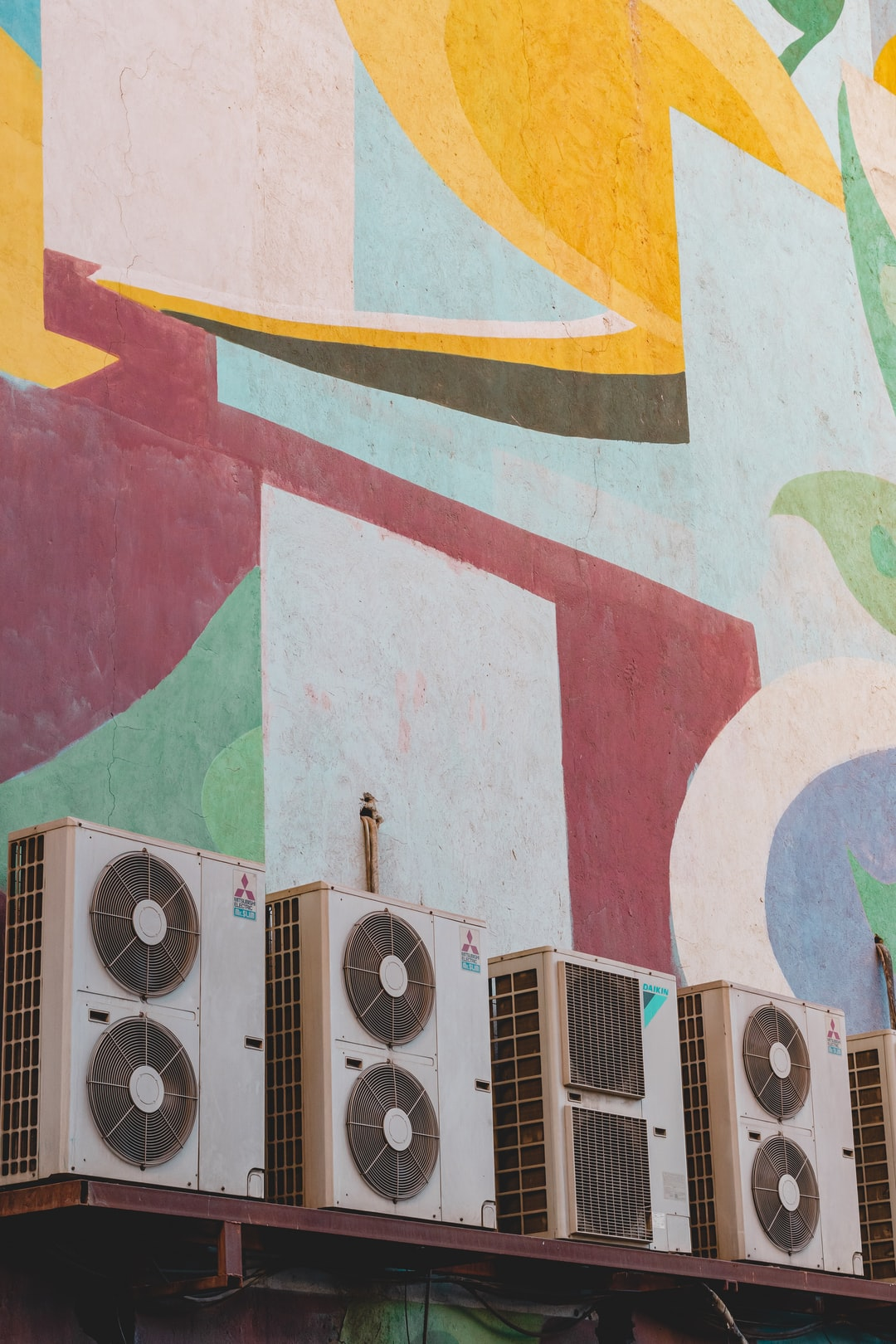 Patterns of the wall of the Bahman cinema and a row of split air conditioners.