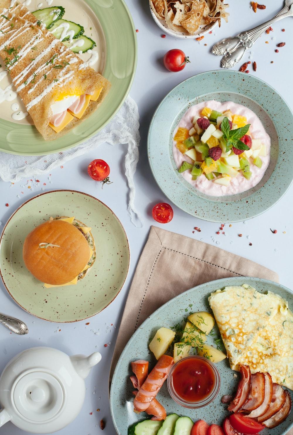burger and egg on plates