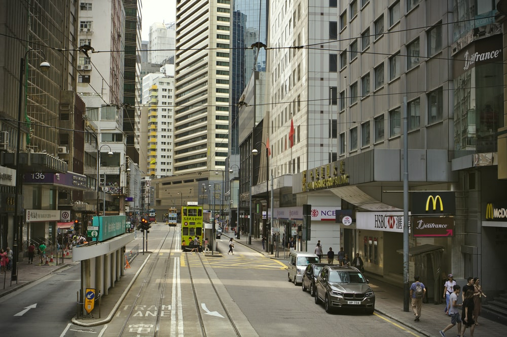 cars on road near buildings