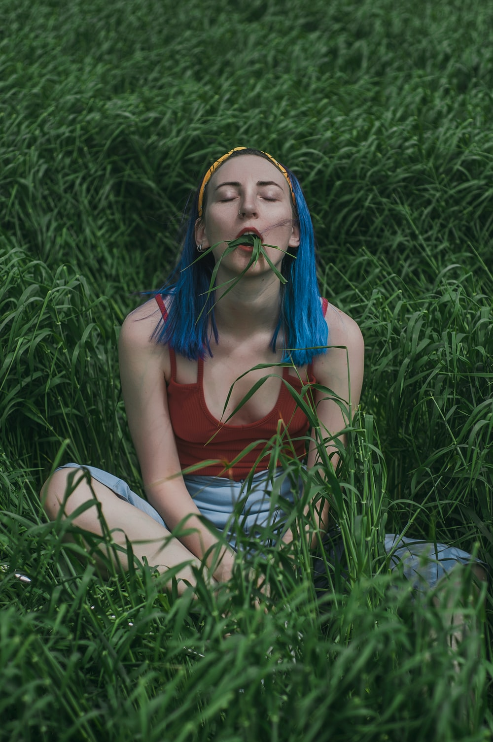 woman sits on grass