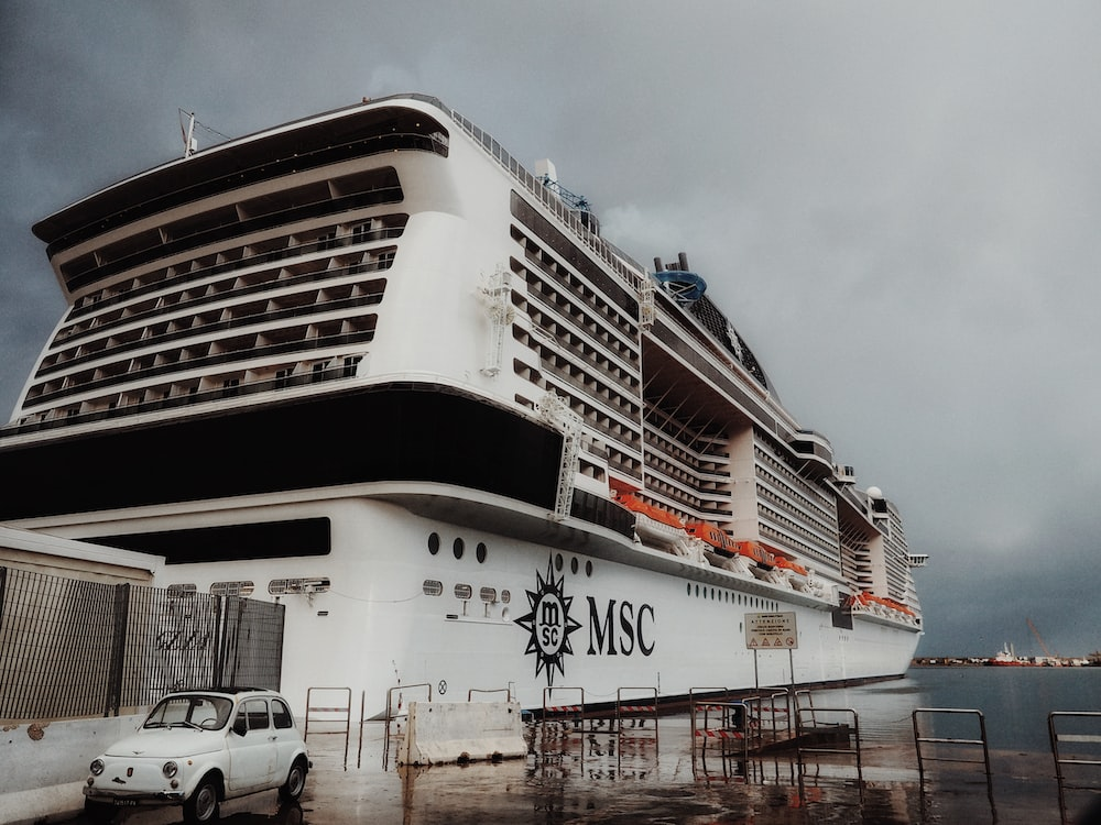 white and black MSC cruise ship