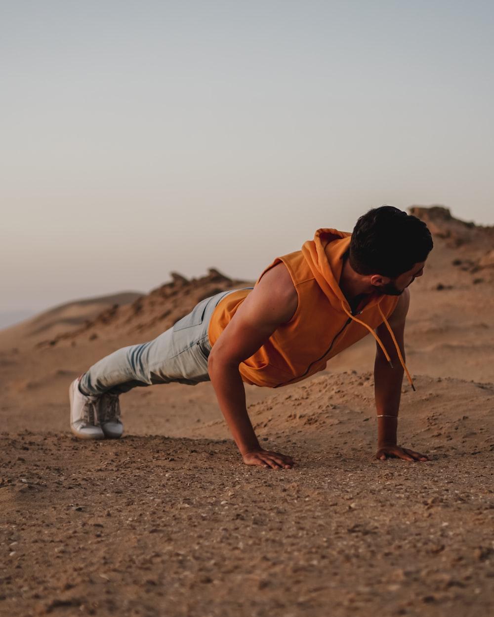 man pushes up on ground