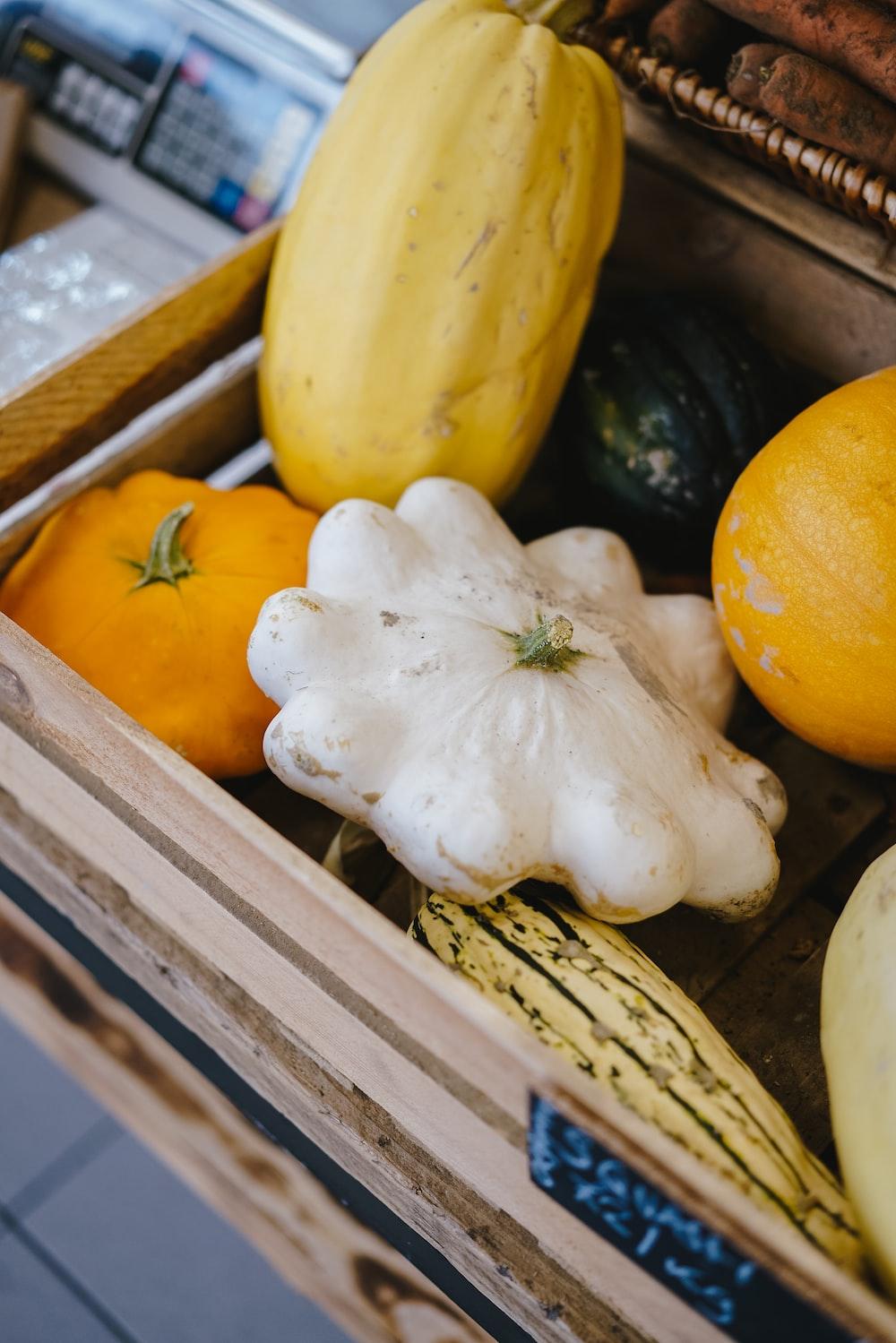 pumpkins on gray wooden crate