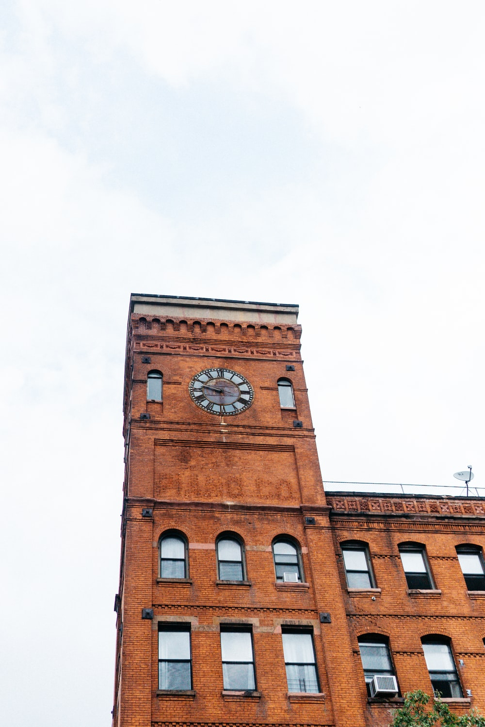 brown building with clock photo